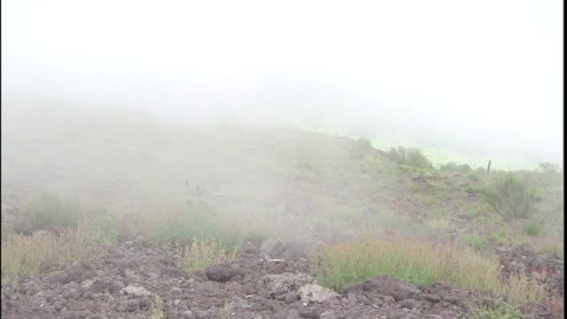 steam rolls across grassy slopes around mt. vesuvius. - steam stock videos & royalty-free footage
