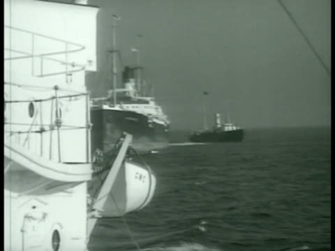 steam ship tug on open water sailors lined up on deck of ship w/ officer ha td group of sailors using sextants exercise 'shooting the sun' - sextant stock videos & royalty-free footage