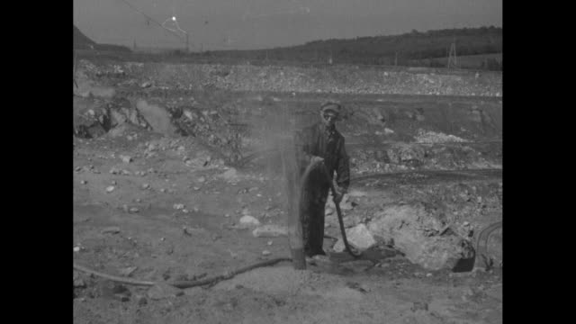 cu steam shovel scoops up dirt and ore at asbestos mine / vs aerials the mine with steam shovel at center / vs men with pole hose water or gas emits... - open collar stock videos and b-roll footage