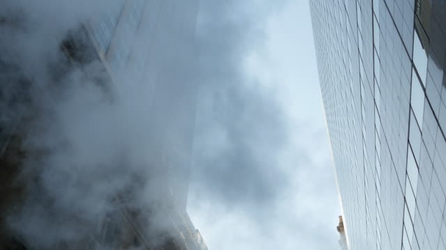 steam smoke blowing through the streets of new york city. global warming pollution background - film tilt stock videos & royalty-free footage