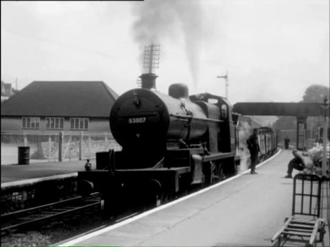 ms pov steam train arriving on pickford truck and man showing steam train to boy /  london, london, england   - steam train stock videos & royalty-free footage