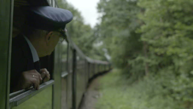 steam train conductor looking out of a train car window - conductor stock videos & royalty-free footage
