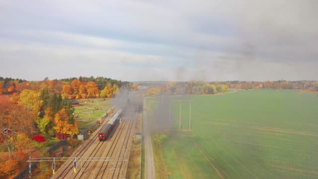 steam train crosses agricultural fields - locomotive stock videos & royalty-free footage