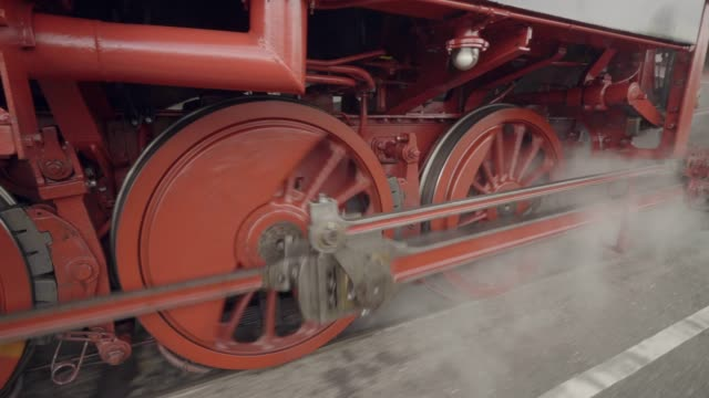 steam train details of wheels in motion with steam - locomotive stock videos & royalty-free footage