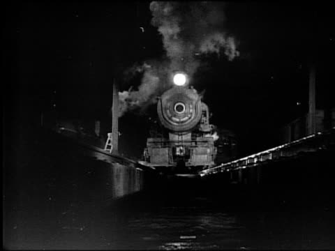 b/w steam train driving on tracks toward + over camera at night - authority stock videos & royalty-free footage
