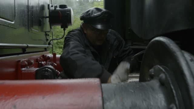 steam train engineer fixing train coupling - locomotive stock videos & royalty-free footage