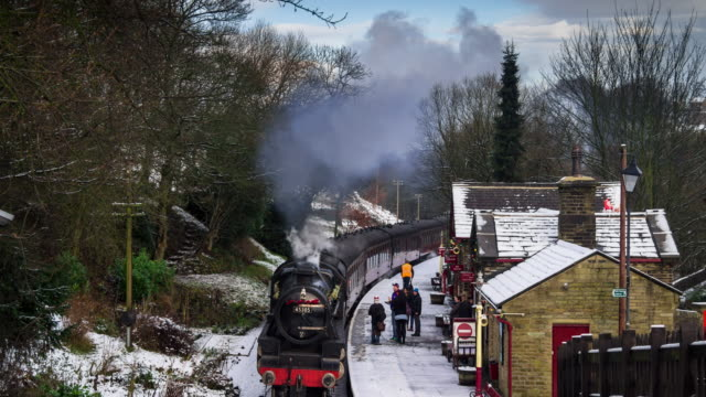 steam train in the snow, haworth, yorkshire - time lapse - bare tree stock videos & royalty-free footage