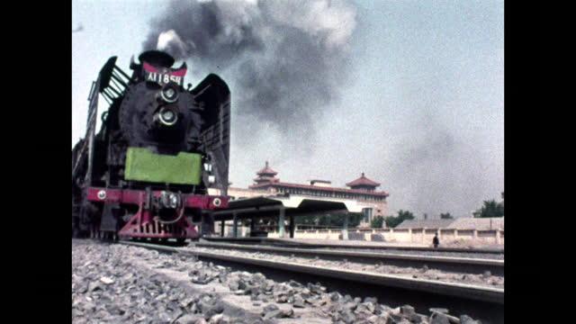 cu of steam train leaving beijing station in 1973 - 革命点の映像素材/bロール