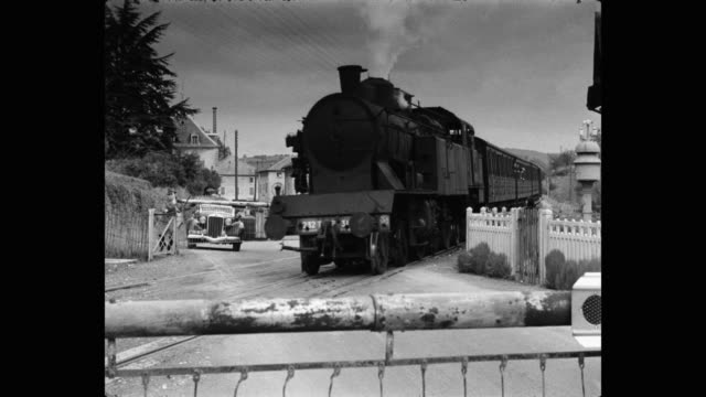 steam train moving at railroad crossing, france - ferrovia video stock e b–roll