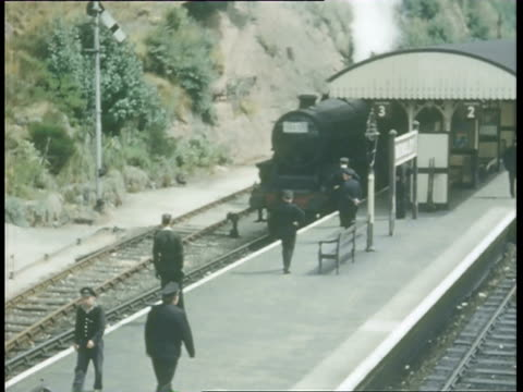 ms pov steam train moving slowly at station and people standing on platform / swindon, wiltshire, england - locomotive stock videos and b-roll footage