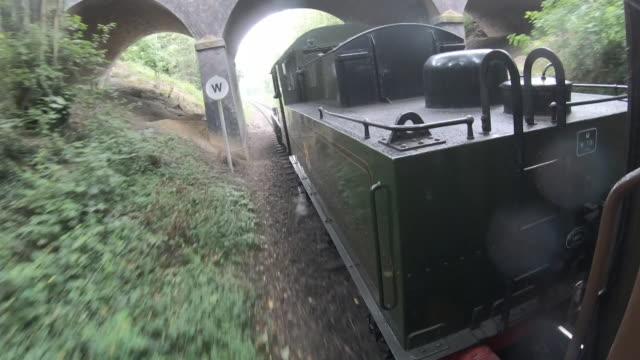 steam train moving through leicestershire countryside - nutzfahrzeug stock-videos und b-roll-filmmaterial