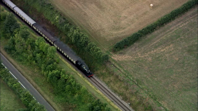 steam train on the west somerset railway  - aerial view - england, somerset, west somerset district, united kingdom - steam train stock videos & royalty-free footage