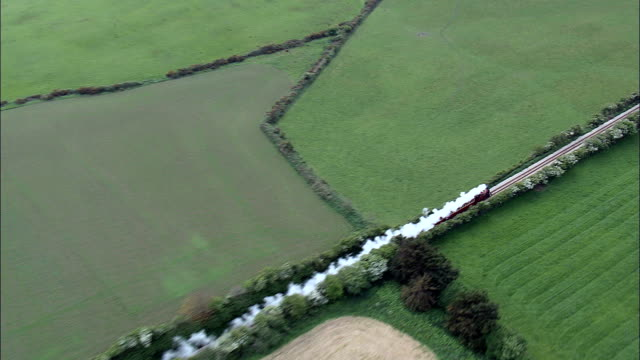 steam train out of ballasalla  - aerial view -, isle of man - steam train stock videos & royalty-free footage