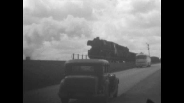 vidéos et rushes de steam train passes at the peninsula usedom at the baltic sea city of ahlbeck with the famous pier views from there car adler parks at prenzlau in... - après guerre