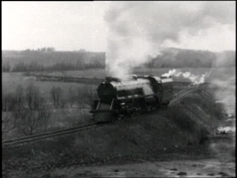 vidéos et rushes de steam train passes through a rural area. - vapeur