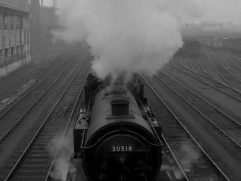 a steam train passes underneath the camera - steam train stock videos & royalty-free footage