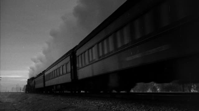 B/W MS steam train passing camera in countryside