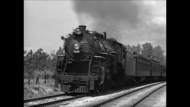 steam train passing on tracks. transportation traveling passenger car. - narrating stock-videos und b-roll-filmmaterial