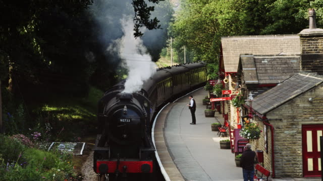steam train pulling into victorian station - village stock videos & royalty-free footage