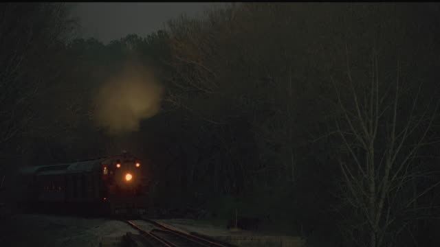 cu, steam train riding through forest at dusk, tennessee, usa - nostalgia stock videos & royalty-free footage