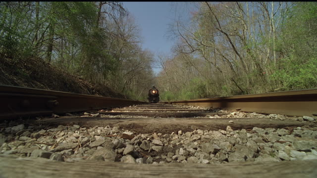 ms, cu, steam train riding through forest over camera, tennessee, usa - the past stock videos and b-roll footage