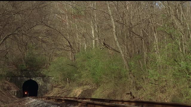 ms, steam train riding through forest, tennessee, usa - the past stock videos and b-roll footage