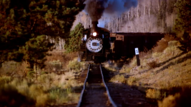 ms, steam train riding through rocky mountains, colorado, usa - cargo train stock videos & royalty-free footage