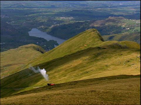 Steam train slowly climbs Snowdon Wales