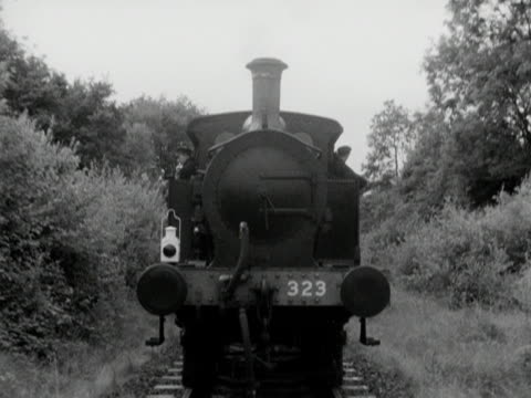 steam train travels backwards along the bluebell railway. - locomotive stock videos & royalty-free footage