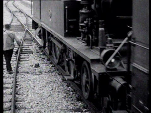 1923 b/w steam train with locomotive rides along the rails / netherlands - 1923 stock-videos und b-roll-filmmaterial