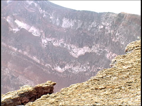 steam wafts above a rocky cliff. - tectonic stock videos & royalty-free footage