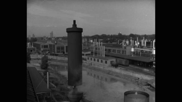 steam whistle emitting steam at industrial area - fischietto video stock e b–roll