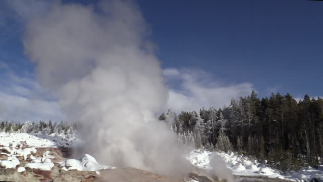 steamboat geyser, yellowstone national park scenic in winter - geyser stock videos & royalty-free footage