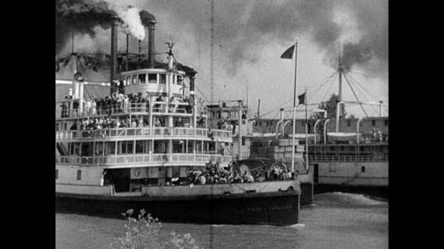 / steamboat going down the river / african american workers loading up the boat / boat sails away / rolling cotton bales down the gang plank /... - steam liner stock videos & royalty-free footage