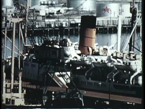 vídeos de stock e filmes b-roll de 1955 montage ha ws ms steamboat loading cargo in harbor, boat moving along coast / new zealand / audio - 1955