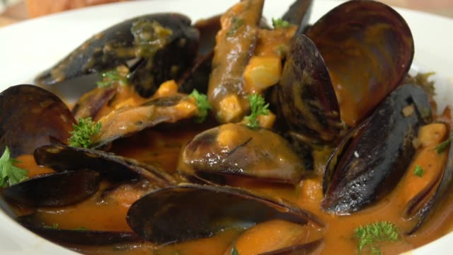 Steamed PEI Mussels and Sourdough Bread in Savory Sauce.
