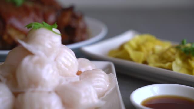 Steamed shrimp dumplings on dining table