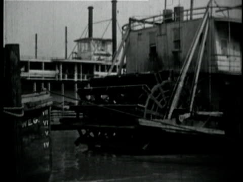 1929 b/w ms steamer moored in port / new orleans, louisiana - river mississippi stock videos & royalty-free footage