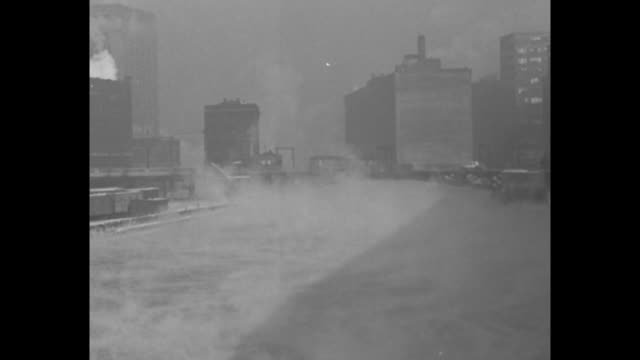 vs steaming chicago river / cu frozen shore and waves / vs steaming chicago river / vs frozen shore and waves / ms man walks down street waving arms... - neckwear stock videos and b-roll footage