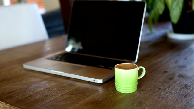 steaming coffee - cinemagraphs - office laptop stock videos & royalty-free footage