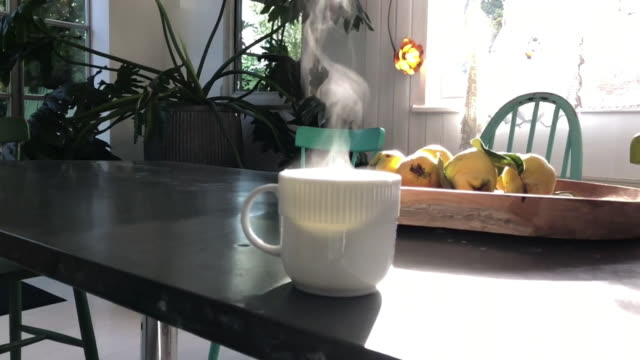 steaming cup of hot tea taken on mobile phone device - dampf stock-videos und b-roll-filmmaterial