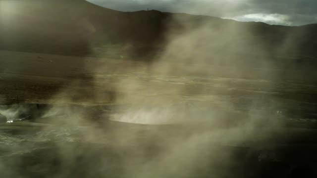 steaming fumaroles. hverarond geothermal area - erupting stock videos & royalty-free footage