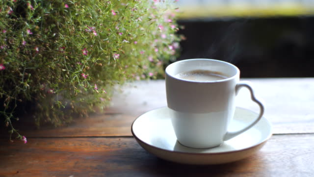 steaming hot coffee cup on outdoor table - cup stock videos & royalty-free footage