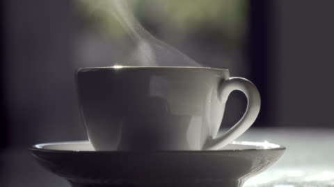 steaming hot drink in backyard picnic party table - cup stock videos & royalty-free footage