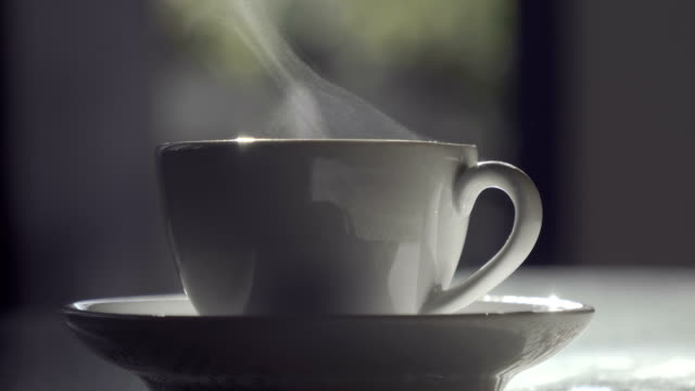 steaming hot drink in backyard picnic party table - tea cup stock videos & royalty-free footage