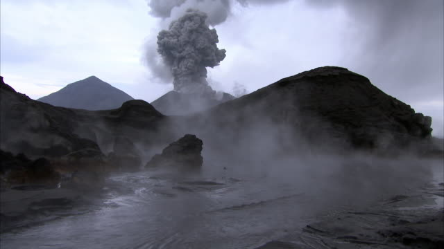 steaming hot spring and erupting volcano, new britain, png - volcano stock videos & royalty-free footage