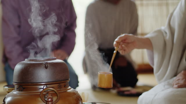 steaming kettle at traditional japanese tea ceremony - kimono stock videos & royalty-free footage