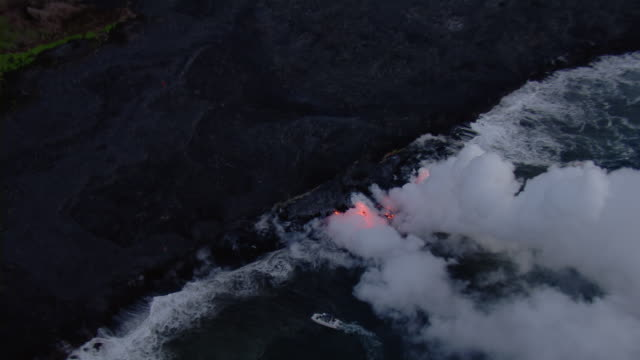 Steaming lava flowing into ocean on the Island of Hawaii.