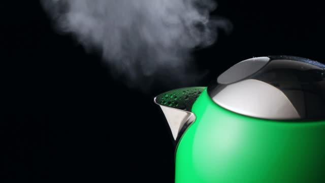 ecu steaming tea kettle / seoul, south korea - tea kettle stock videos & royalty-free footage
