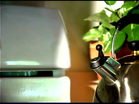steaming tea kettle - tea kettle stock videos & royalty-free footage